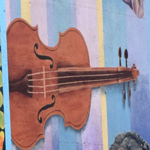 painting of a guitar on a colorful background